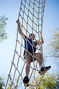 Dean Gaboury climbs up the ziplining tower at the Challenge Course at The Ridges. Photo by Hannah Ruhoff