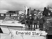 New Facilities At Emerald Star Line.   (R59)..1987..08.06.1987..06.08.1987..8th June 1987..the Minister for Transport and Tourism, Mr John Wilson TD opened a new Customer Service Facility at Emerald Star Line,Carrick on Shannon. Following the viewing of the facility and the planting of a commemorative tree, the Minister, accompanied by Mr Brian Slowey,Managing Director, Guinness,Ireland and Mr E H Bodell, Chairman, Emerald Star line departed on a cruise of The Shannon aboard an Emerald Star Cruiser...Image shows the Minister, John Wilson TD taking command of one of the Emerald Star Cruisers. On board are; Mr P J Ryan,M D,Emerald Star Line,Mr E H Bodell,Chairman Emerald Star Line, Mr Michael McDonnell,Asst Sec,dept of Tourism, Mr Brian Slowey, M D, Guinness Ireland,Deputy John Ellis,Chairman, Leitrim Co Council and Mr Paddy Doyle, County Manager..