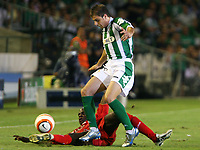 Betis' Joaquin is challenged by Liverpool's Momo Sissoko during their Champions League match in Ruiz de Lopera stadium in Seville, Spain, Tuesday 13 September, 2005. (Photo / Alvaro Hernandez)