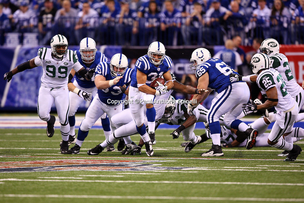 Indianapolis Colts running back Donald Brown (31) runs for a first quarter first down during the AFC Championship football game against the New York Jets, January 24, 2010 in Indianapolis, Indiana. The Colts won the game 30-17. ©Paul Anthony Spinelli