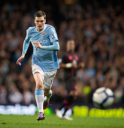 MANCHESTER, ENGLAND - Wednesday, March 24, 2010: Manchester City's Adam Johnson in action against Everton during the Premiership match at the City of Manchester Stadium. (Photo by David Rawcliffe/Propaganda)