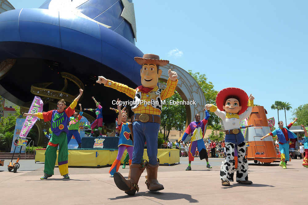 Toy Story characters dance in a parade at Disney's Hollywood Studios theme park in Lake Buena Vista, Florida.