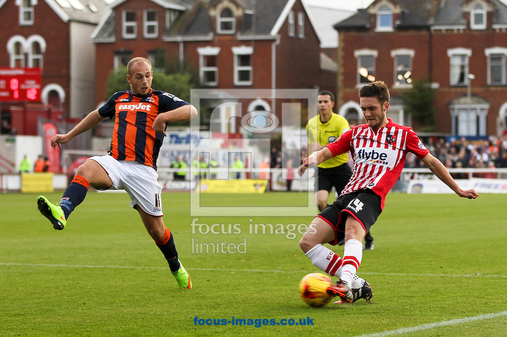 Matt Grimes (right) of Exeter City crosses the ball into the box as Jake Howells (left) of Luton Town tries to stop him during the Sky Bet League 2 match at St James' Park, Exeter<br /> Picture by Tom Smith/Focus Images Ltd 07545141164<br /> 01/11/2014