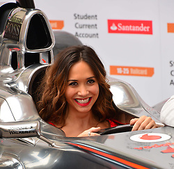 Jenson Button and Myleene Klass photocall.<br /> Formula 1 star Button (not in frame) is joined by the TV personality Myleene Klass to pose for pictures with a McClaren car to promote the car manufacturer's sponsor Santander. British Medical Association, <br /> London, United Kingdom,<br /> Wednesday, 26th June 2013<br /> Picture by Nils Jorgensen / i-Images