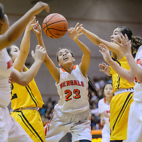 Gallup Bengal Mckleigh Begaye (23) loses the ball as she's fouled by the St. Pius Sartans Friday at Gallup High School.