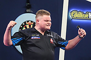 Harry Ward wins his first round match against Madars Razma and celebrates during the PDC William Hill World Darts Championship at Alexandra Palace, London, United Kingdom on 17 December 2019.