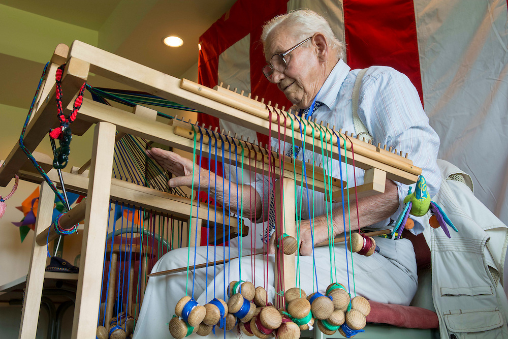 Dick Hodge, of Christchurch demonstrates Kumihimo, the Japanese craft of silk braiding on a Takadai at the Canterbury Japan Day, Christchurch , New Zealand, Sunday, 23 February, 2014.  <br /> Credit:SNPA / David Alexander