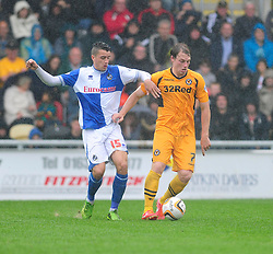 Bristol Rovers' Oliver Norburn jostles for the ball with Newport County's Adam Chapman  - Photo mandatory by-line: Dougie Allward/JMP - Tel: Mobile: 07966 386802 17/08/2013 - SPORT - FOOTBALL - Rodney Parade - London - Newport County V Bristol Rovers - Sky Bet league two