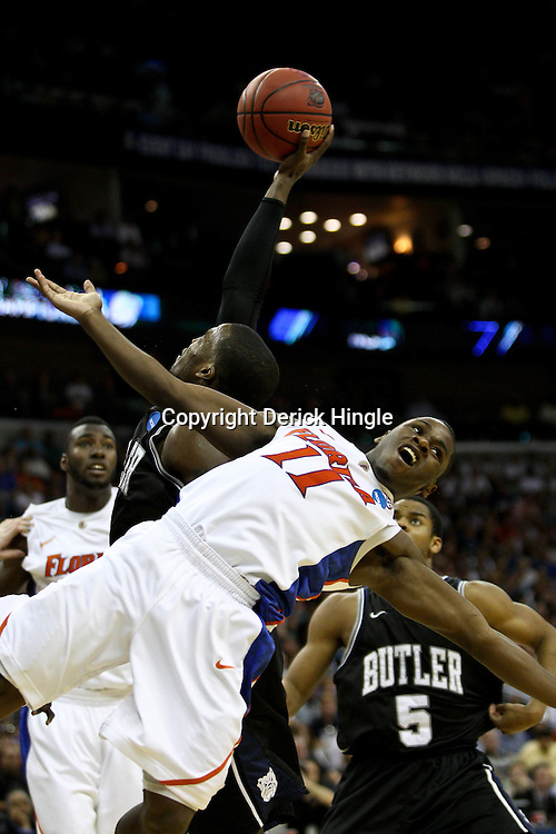 Mar 26, 2011; New Orleans, LA; Butler Bulldogs guard Shelvin Mack (1) rebounds over Florida Gators guard Erving Walker (11) during the second half of the semifinals of the southeast regional of the 2011 NCAA men's basketball tournament at New Orleans Arena.   Mandatory Credit: Derick E. Hingle