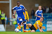 Gillingham FC forward Mikael Ndjoli  (10) and Southend United forward Simon Cox  (10) during the EFL Sky Bet League 1 match between Gillingham and Southend United at the MEMS Priestfield Stadium, Gillingham, England on 5 October 2019.