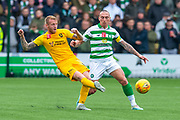 Robbie Crawford (#16) of Livingston FC clears the ball ahead of Scott Brown (#8) of Celtic FC during the Ladbrokes Scottish Premiership match between Livingston FC and Celtic FC at The Tony Macaroni Arena, Livingston, Scotland on 6 October 2019.