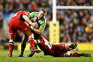 Picture by Andrew Tobin/Focus Images Ltd. 07710 761829. .27/12/11. Joe Marler (1) of Harlequins is tackled by Rhys Gill (1) of Saracens (L) and George Kruis (5) of Saracens (R) during the Aviva Premiership match between Harlequins and Saracens at Twickenham Stadium, London.
