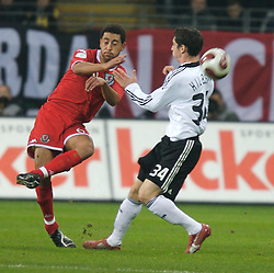 FRANKFURT, GERMANY - Wednesday, November 21, 2007: Wales' Lewin Nyatanga and Germany's Roberto Hilbert during the final UEFA Euro 2008 Qualifying Group D match at the Commerzbank Arena. (Pic by David Rawcliffe/Propaganda)