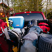 KGB Productions pick up truck filling up with gear before heading out on a filming mission in Glacier National Park.