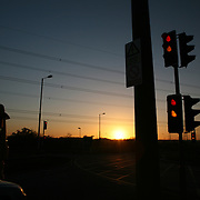 Traffic on Junction with traffic lights at sunset.