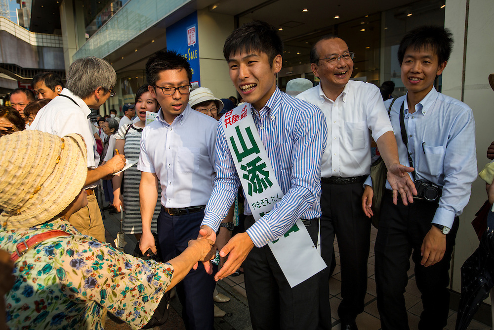 TOKYO, JAPAN - JULY 7 :  Taku Yamazoe, candidate from The Japanese Communist Party (JCP) greets supporters after his speech in Ueno, during the Upper House election campaign outside of Ueno Station, Tokyo, Japan on July 7, 2016. Japan's upper house election will be held on this coming Sunday July 10, 2016. (Photo by Richard Atrero de Guzman/NURPhoto)
