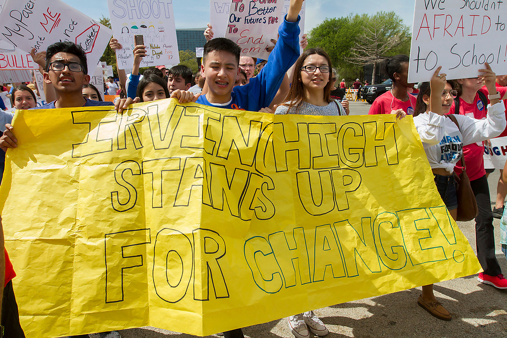 Students from Irving HS march for gun reform and sensible gun control during the March for out lives at Dallas City hall on Saturday.