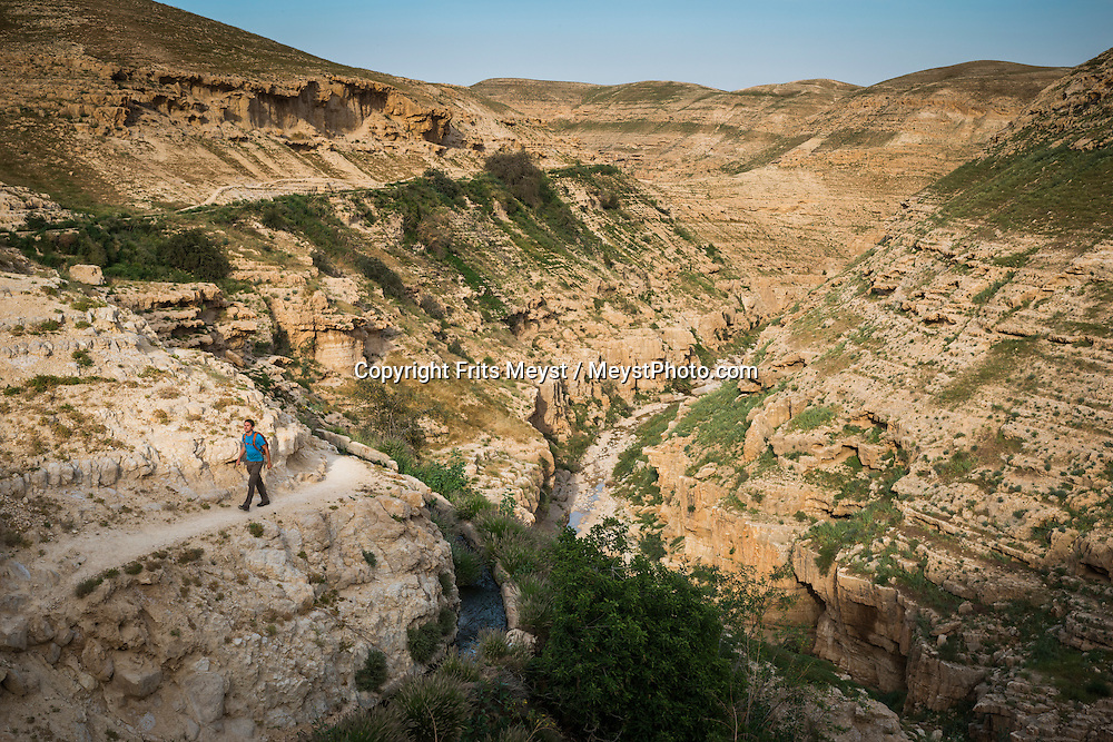"Jericho, Palestine, March 2015. St George's Monastery. The rocky canyon of Wadi Qelt is often associated with the ""valley of the shadow of death"" from Psalm 23, and in the blistering heat of summer the moniker seems to suit just fine. In this isolated, barren and rocky spot a 4th-century monastery clings to the rockwalls.  The Abraham Path is a long-distance walking trail across the Middle East which connects the sites visited by the patriarch Abraham. The trail passes through sites of Abrahamic history, varied landscapes, and a myriad of communities of different faiths and cultures, which reflect the rich diversity of the Middle East. Photo by Frits Meyst / MeystPhoto.com for AbrahamPath.org"