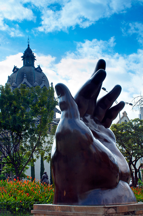 Fernando Botero's sculpture 'The Hand', sits in the Plaza Botero.  Botero is a native son of Medellin and donated 23 of his most famous sculptures to sit in the plaza.