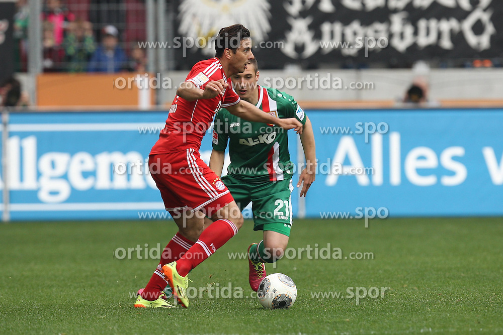 05.04.2014, SGL Arena, Augsburg, GER, 1. FBL, FC Augsburg vs FC Bayern Muenchen, 29. Runde, im Bild l-r: im Zweikampf, Aktion, mit Claudio Pizzarro #14 (FC Bayern Muenchen) und Dominik Kohr #21 (FC Augsburg) // during the German Bundesliga 29th round match between FC Augsburg and FC Bayern Munich at the SGL Arena in Augsburg, Germany on 2014/04/06. EXPA Pictures &copy; 2014, PhotoCredit: EXPA/ Eibner-Pressefoto/ Kolbert<br /> <br /> *****ATTENTION - OUT of GER*****