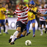 Jermaine Jones, USA, is fouled while challenged by Sandro, Brazil, during the USA V Brazil International friendly soccer match at FedEx Field, Washington DC, USA. 30th May 2012. Photo Tim Clayton