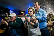 Senator and 2016 Republican presidential candidate, Ted Cruz (R-TX), hugs his wife, Heidi, as he prepares to speak to potential supporters during a campaign event at the Generations Bar and Grill in Ringsted, IA on January 29, 2016. Cruz is in Iowa campaigning in the final days before the Iowa Caucus. <br />