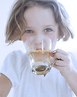 Close-up view of Young girl drinking cup of tea