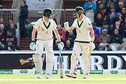 Steve Smith of Australia comes out to bat and is given a briefing by Marnus Labuschagne of Australia during the International Test Match 2019, fourth test, day one match between England and Australia at Old Trafford, Manchester, England on 4 September 2019.