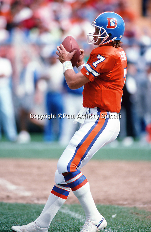 Denver Broncos quarterback John Elway (7) drops back to pass during the NFL football game against the Seattle Seahawks on Sept. 15, 1991 in Denver. The Broncos won the game 16-10. (©Paul Anthony Spinelli)