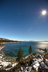 """Sand Harbor at Night 1"" - Photograph of Sand Harbor in the distance shot at night (early morning) with the bright moon and stars visible."
