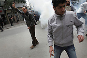 Protesters in the teargas during a  demonstration in the center of Tunis. People still protest against the partecipation of the Constitutional Democratic Rally, RCD, party of Ben Ali, to the national unity government that today january 18 lost three ministers of the opposition.