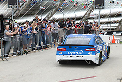 April 6, 2018 - Fort Worth, TX, U.S. - FORT WORTH, TX - APRIL 06: Fans line the path as drivers leave the garage during practice for the O'Reilly Auto Parts 500 on April 6, 2018 at Texas Motor Speedway in Fort Worth, Texas.  (Photo by George Walker/Icon Sportswire) (Credit Image: © George Walker/Icon SMI via ZUMA Press)