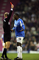 Emile Heskey is shown the Red Card by Referee Mike Riley<br />