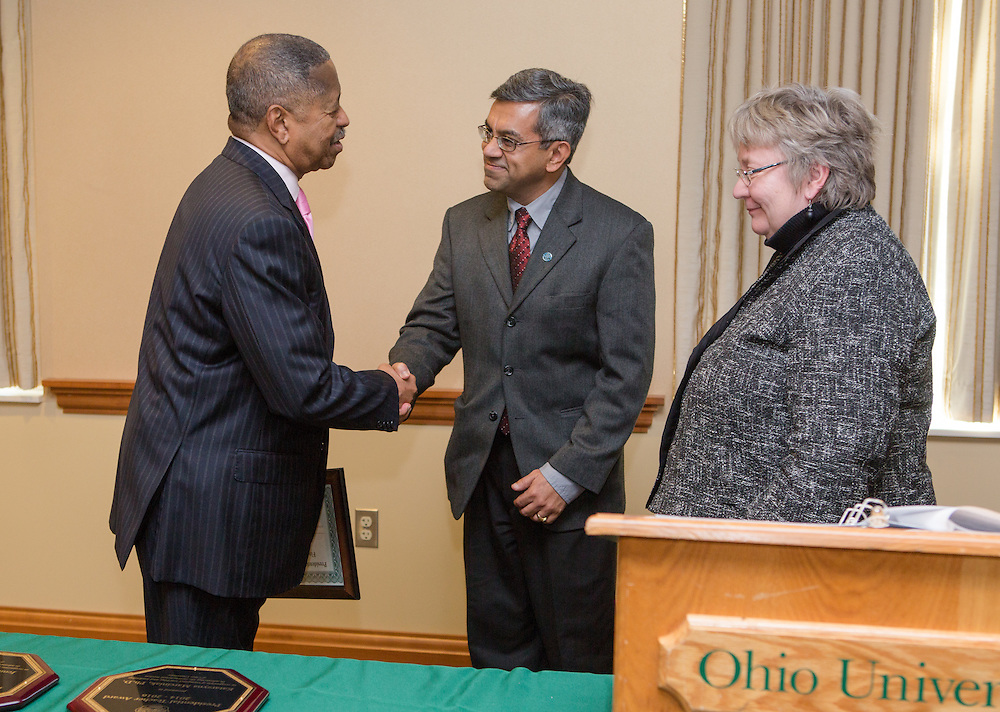 Ohio University President Roderick McDavis and Executive Vice President and Provost Pam Benoit congratulate Vic Matta during the Presidential Teacher Awards in the Multicultural Center on Sept. 23, 2014. Photo by Lauren Pond