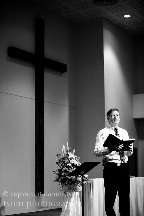 Senior Pastor John Teschan presiding over the first service of the new Evangelical Church of Bangkok (ECB) Fellowship Hall in Bangkok, Thailand