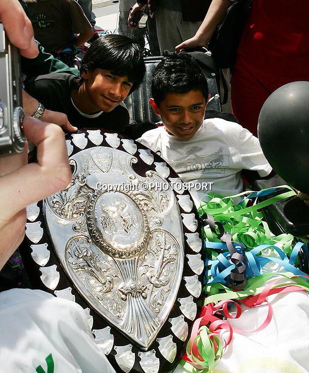 Young Harbour fans celebrate with the ranfury shield during the street parade for the North Habour Air NZ Cup team who won the Ranfurly Shield last weekend, at Takapuna, Auckland, on Thursday 28 September 2006. Photo: Tim Hales/PHOTOSPORT<br />