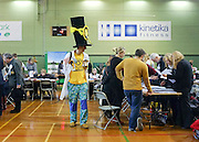 © Licensed to London News Pictures. 01/03/2013. Eastleigh, UK A member of the Monster Raving Loony Party walks around the hall. Ballot boxes begin to arrive at the count centre at  Fleming Park Leisure Centre in Eastleigh this evening. The voters of Eastleigh vote to choose a new MP in a by-election prompted by the resignation of former Lib Dem cabinet minister Chris Huhne. Polling will continued 22:00 GMT 28/02/13, with votes counted overnight on Thursday. There are 14 candidates in total on the ballot papers.. Photo credit : Stephen Simpson/LNP