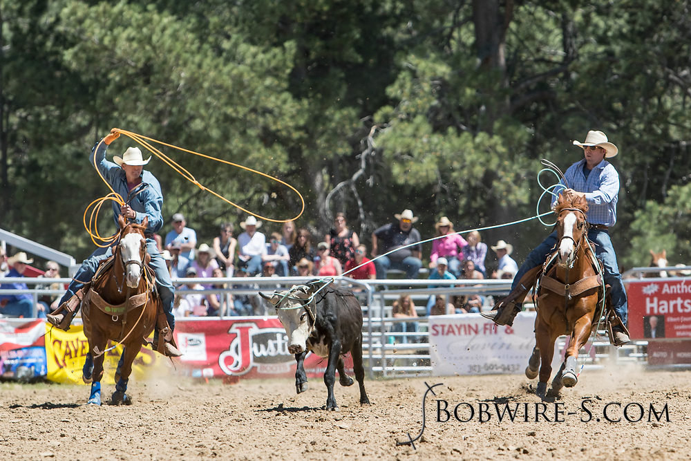 Header Corey Whinnery and heeler Robert Murphy make their team roping run in the first performance of the Elizabeth Stampede on Saturday, June 2, 2018.