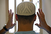 A Muslim prisoner prays in his cell at Wandsworth prison..HMP Wandsworth in South West London was built in 1851 and is one of the largest prisons in Western Europe. It has a capacity of 1456 prisoners.