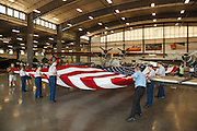 Refolding the flag for the Flag Day Ceremony.