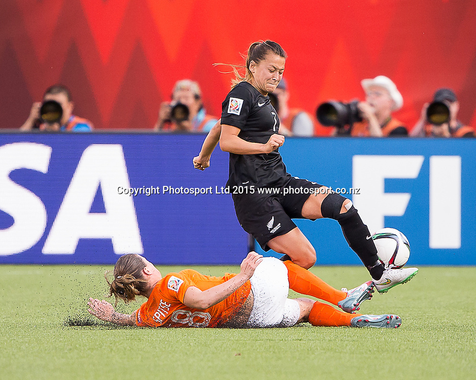 Ali Riley, Sherida Spitse. Edmonton, Alberta, Canada, June 6, 2015.  The opening day of the Women's World Cup at Commonwealth Stadium.  New Zealand was defeated by Netherlands 1-0.