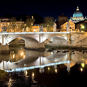 Rome cityscape reflected on Tiber in Rome, Italy.
