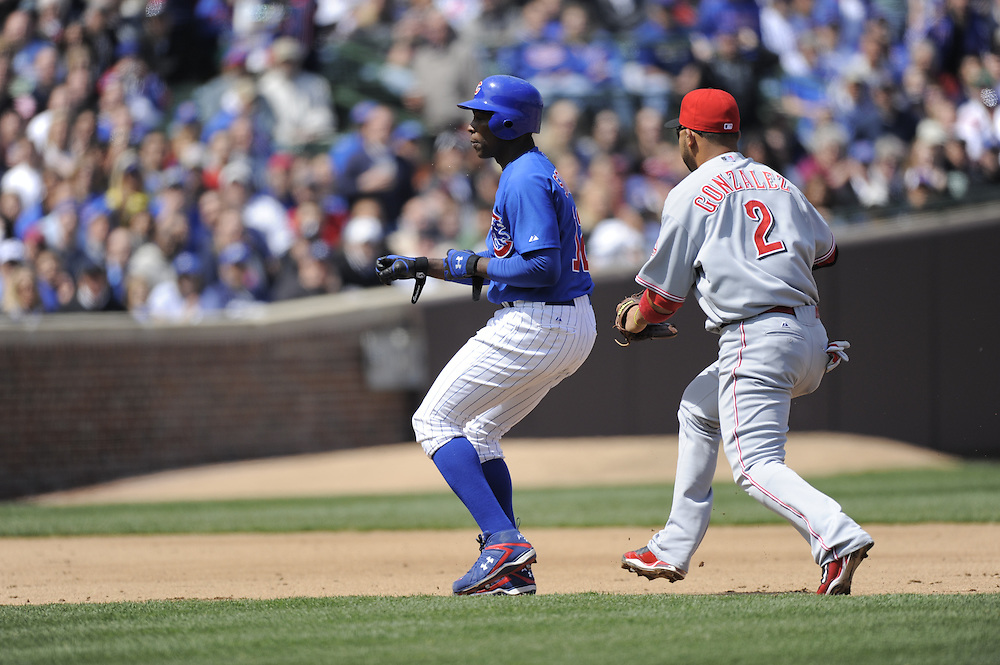 CHICAGO - APRIL 23:  Alfonso Soriano #12 of the Chicago Cubs is tagged out in a rundown by Alex Gonzalez #2 of the Cincinnati Reds on April 23, 2009 at Wrigley Field in Chicago, Illinois.  The Reds defeated the Cubs 7-1.  (Photo by Ron Vesely)