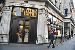 © Licensed to London News Pictures. 24/11/2017. London, UK. Barriers and no queues outside Canada Goose. Oxford Street in London almost empty shortly after 8am on the Morning of Black Friday sales. Many shops open early in the morning of Black Friday to offer offer promotional sales on items ahead of the Christmas period. Promotions have been scaled down in recent years after violence broke out at some shops between customers fighting for discounted items. Photo credit: Ben Cawthra/LNP
