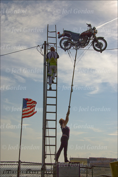 The Skycycle Trapeze act, a thin stretched steel cable is the aerial highway as they ride into the sky while precariously balancing a motorcycle with a trapeze underneath across the Steel Pier and the boardwalk in Atlantic City.