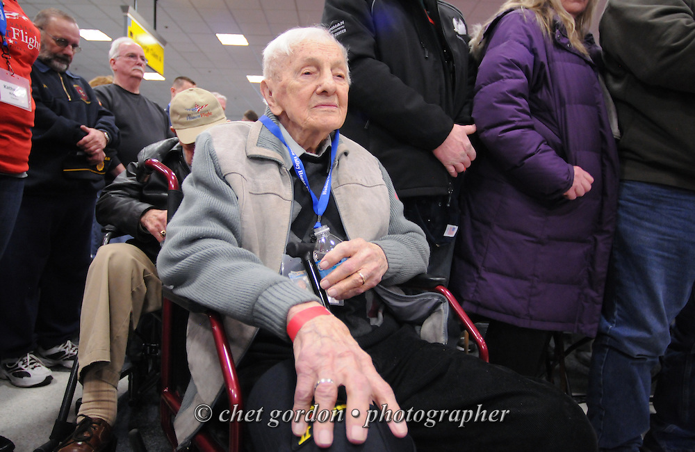WWII Veterans and their escorts onboard the Hudson Valley Honor Flight at the Flight Day sendoff at Stewart International Airport in Newburgh, NY on Saturday, April 11, 2015. Nearly 100 Veterans from the Orange County (NY) region toured the WWII, Korean, Vietnam, and USMC War Memorials, as well as Arlington National Cemetery. Hudson Valley Honor Flight is a chapter of the Honor Flight Network, which provides free flights for WWII Veterans and tours of the WWII Memorial constructed in their honor, and other sites in the nation's capital.  © Chet Gordon for Hudson Valley Honor Flight