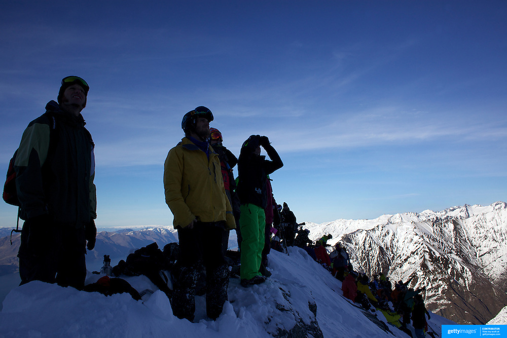 Competitors study the mountain before competition during the World Heli Challenge Extreme Day at Mount Albert on Minaret Station, Wanaka, New Zealand. 1st August 2011