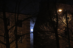 January 2, 2018 - Riga, Latvia - The supermoon is visible on one of the streets in the center of Riga. Latvia, Tuesday, January 2, 2018 The supermoon phenomenon occurs when the moon, which follows an elliptical orbit around the Earth, reaches a point closer than usual. (Credit Image: © Danil Shamkin/NurPhoto via ZUMA Press)