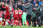 Liverpool midfielder Jordan Henderson (14) and Liverpool Manager Jurgen Klopp applaud the fans during the Premier League match between Liverpool and Watford at Anfield, Liverpool, England on 14 December 2019.