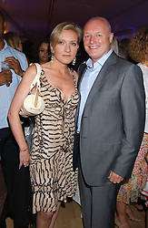 Chief executive of Chelsea FC PETER KENYON and LOUISE QUINN at party in aid of cancer charity Clic Sargent held at the Sanderson Hotel, Berners Street, London on 4th July 2005.<br /><br />NON EXCLUSIVE - WORLD RIGHTS